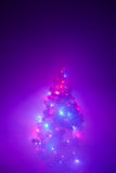 Christmas tree lights garland in frozen mist Royalty Free Stock Photo
