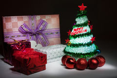 Christmas tree with lights and gift box Stock Photos