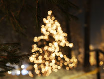 Christmas tree with lights glowing. And snow Stock Photos
