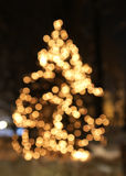 Christmas tree with lights glowing. And snow Stock Photography