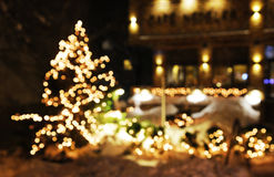 Christmas tree with lights glowing. And snow Stock Image