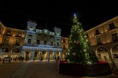 Christmas Tree with lights glowing on a town square in Avila , S. Avila, Spain; December 2016: Christmas Tree with lights glowing on a town square in Avila royalty free stock image