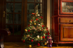 Christmas tree with lights on at home Royalty Free Stock Images