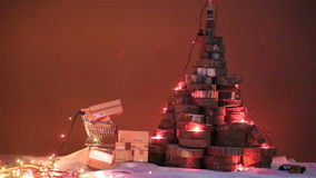 Christmas tree and lights. Christmas tree made of tree trunks and Christmas lights and presents stock video footage