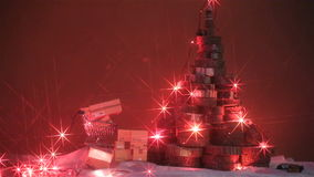 Christmas tree and lights. Christmas tree made of tree trunks and Christmas lights and presents stock footage