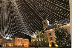 Christmas tree and lights in old town square Royalty Free Stock Photo