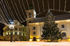 Christmas tree and lights in old town square stock photo
