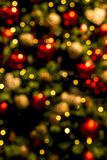 Christmas tree with lights and ornaments blurred. Christmas tree full of golden ornamants blurred to be used as a background Stock Photos