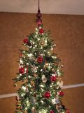 Christmas tree with lights and ornaments. Royalty Free Stock Photos