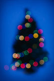 Christmas tree with lights out of focus Stock Photo