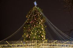 Christmas tree with lights outdoors at night in Kiev. Sophia Cathedral on background. New Year Celebration.  stock photography