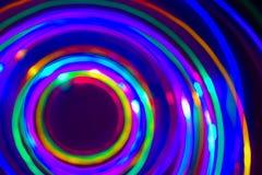 Christmas tree lights spun around to achieve a spiral glowing ef Stock Photos