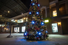 Christmas tree in lights on street at night Stock Image