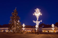 Christmas tree and lights in town square Stock Images