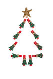 Christmas tree lined clothespins. On an isolated background Stock Images