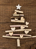 Christmas tree with little hearts. Made of dry wooden branches Stock Image