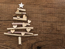 Christmas tree with little hearts. Made of dry wooden branches Royalty Free Stock Image