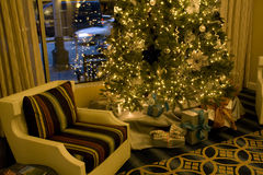 Christmas tree in living room. An elegant Christmas tree with gift wraps in hotel living room Royalty Free Stock Images