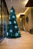 Christmas tree in lobby of a building royalty free stock photos