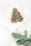 Christmas tree lolly on a festive Christmas snow background Stock Image