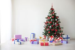 Christmas tree lots of gifts the new year decor royalty free stock photos
