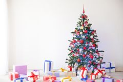 Christmas tree lots of gifts the new year decor royalty free stock photography