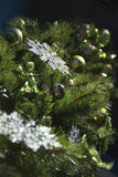 Christmas tree. Low-angle shot of a christmas tree, decorated with gold, green and clear snowflake ornaments Royalty Free Stock Photos