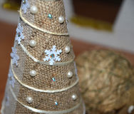 Christmas tree made of bagging and pearls Royalty Free Stock Images