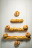 Christmas tree made of baguette and bread roll Royalty Free Stock Photo