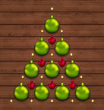 Christmas tree made of baubles on wooden background. Illustration Christmas tree made of baubles on wooden background - vector stock illustration