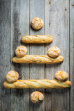 Christmas tree made of bread roll and baguette Royalty Free Stock Image