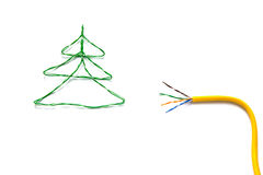 Christmas tree made from cables of Twisted pair RJ45 and yellow patch cord for Lan network. Royalty Free Stock Image