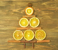 Christmas tree made of cinnamon sticks and slices of orange Royalty Free Stock Images