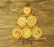 Christmas tree made of cinnamon sticks and slices of orange Stock Image