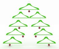 Christmas tree made of clothes hangers decorated with red balls Royalty Free Stock Images