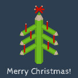 Christmas tree made of colored pencils and the words Merry Christmas Royalty Free Stock Images