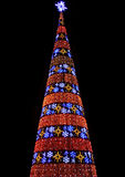 Christmas tree made of colorful lamps. Isolated on black background Stock Photo