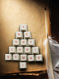 Christmas tree made of computer keys and feather, Old paper background. Christmas card - Christmas tree made of computer keys and feather, Old paper background Royalty Free Stock Photography
