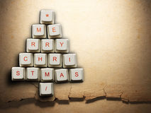 Christmas tree made of computer keys, Old paper background Stock Images