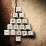 Christmas tree made of computer keys, Old paper background Royalty Free Stock Photo