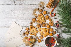 Christmas tree made by cookies  and cinnamon  with Christmas attributes on the white wooden table top view Royalty Free Stock Photography