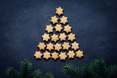 Christmas tree made of cookies. Christmas or New Year tree made of stars shaped cookies. Abstract image with copy space. Holiday, Christmas, New Year concept royalty free stock images