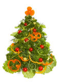Christmas tree made of different vegetarian food. Isolated on white background Stock Photos