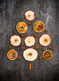 Christmas tree made dry apples, oranges and anise on gray texture. Background royalty free stock photography