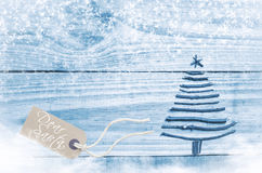 Christmas tree made from dry sticks on wooden, blue background. Royalty Free Stock Photography