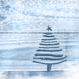 Christmas tree made from dry sticks on wooden, blue background. Royalty Free Stock Photo