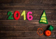 2016 Christmas tree made of felt. Childish New year background. Royalty Free Stock Images