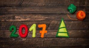 2017 Christmas tree made of felt. Childish New year background w Royalty Free Stock Photo
