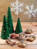 Christmas tree made of felt and gifts Stock Photography