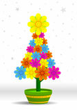 Christmas tree made of flowers of different colors in a green flowerpot on white background with stars Royalty Free Stock Images